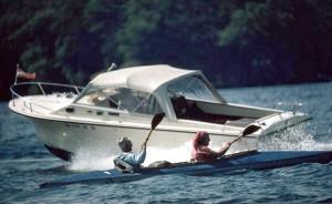 kayakersBoat