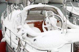boat with snow in harbor